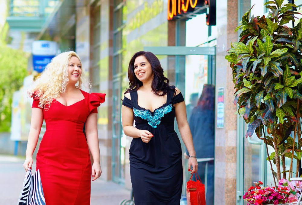 happy plus size women shopping