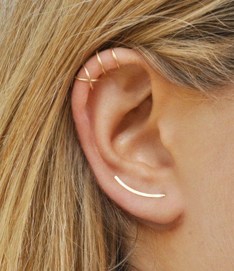 Benittamoko gold line earring